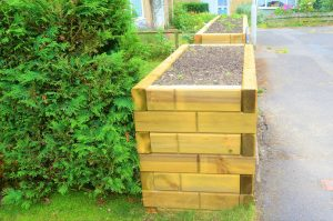 Jakwall Timbers used as a raised front garden flower bed