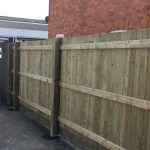 Traditional Featherboard Fencing Run back with Courtyard gate in background