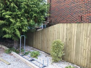 Traditional Featherboard Timber Fencing with decline at end