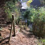 Stake fencing install on steep hill