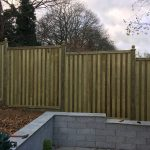 Fence panels installed on hill